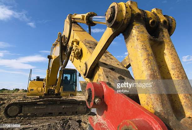Yellow and red excavator on a construction site