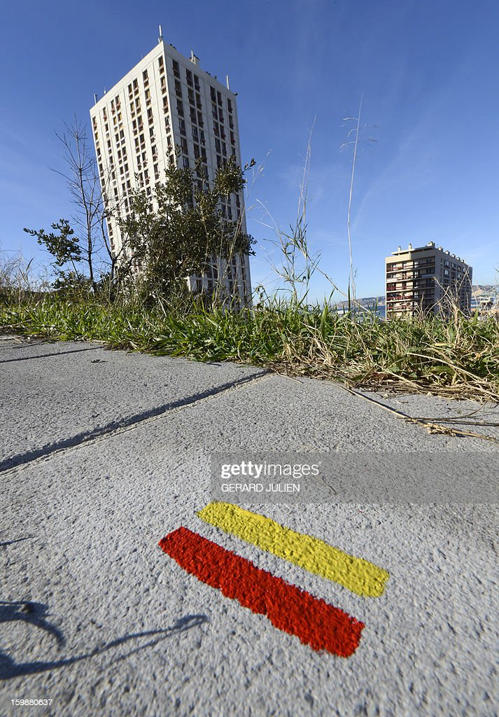 A yellow and red marker is left by volunteers of the 'Fédération Française de Randonnée Pédestre' (FFRP - French Federation of Pedestrian Hiking) to mark the path of the GR2013 hiking route in Marseille, on January 22, 2013. The GR2013 hiking route was established as part of the 'Marseille-Provence European Capital of Culture 2013' program, which sees Marseille host a variety of cultural activities throughout the year. The GR2013 path is 360kms long and crosses through both urban and natural areas, forming an infinity symbol and loop. The GR2013 will be ready and open to the public as of March 22.