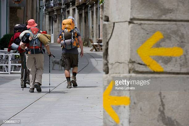 A yellow arrow indicates the Camino de Santiago pilgrims in the town of Sarria Galicia 1th June 2010