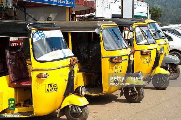 Yellow auto rickshaws lined up in Ooty, Nilgiri Hills, Kerala