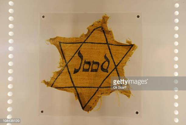 A yellow badge worn by Jewish man Barnett Greenman in the Jewish Museum's exhibition of Holocaust artifacts is displayed on Holocaust Memorial Day on...
