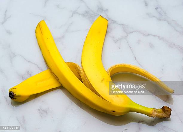 Yellow banana peel over floor marble surface Loosely dropped this peel can be a slippery danger