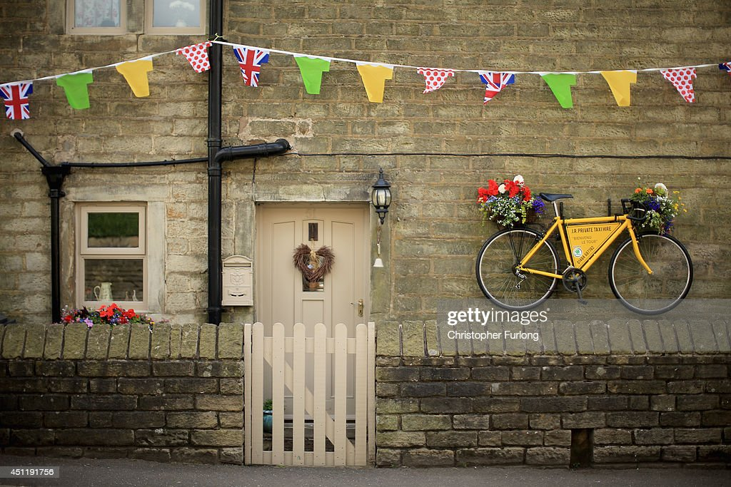 A yellow bicycle hangs from the wall of a stone cottage as Yorkshire prepares to host the Tour de France Grand Depart, on June 24, 2014 in Holmfirth, United Kingdom. The people of Yorkshire are preparing to give the riders of the 2014 Tour de France a grand welcome as the route of stages one and two are decorated with bunting, bikes and yellow jerseys The Grand Depart of the 2014 Tour De France is taking place in Leeds with the first two stages taking place across Yorkshire on 6th and 7th of July.