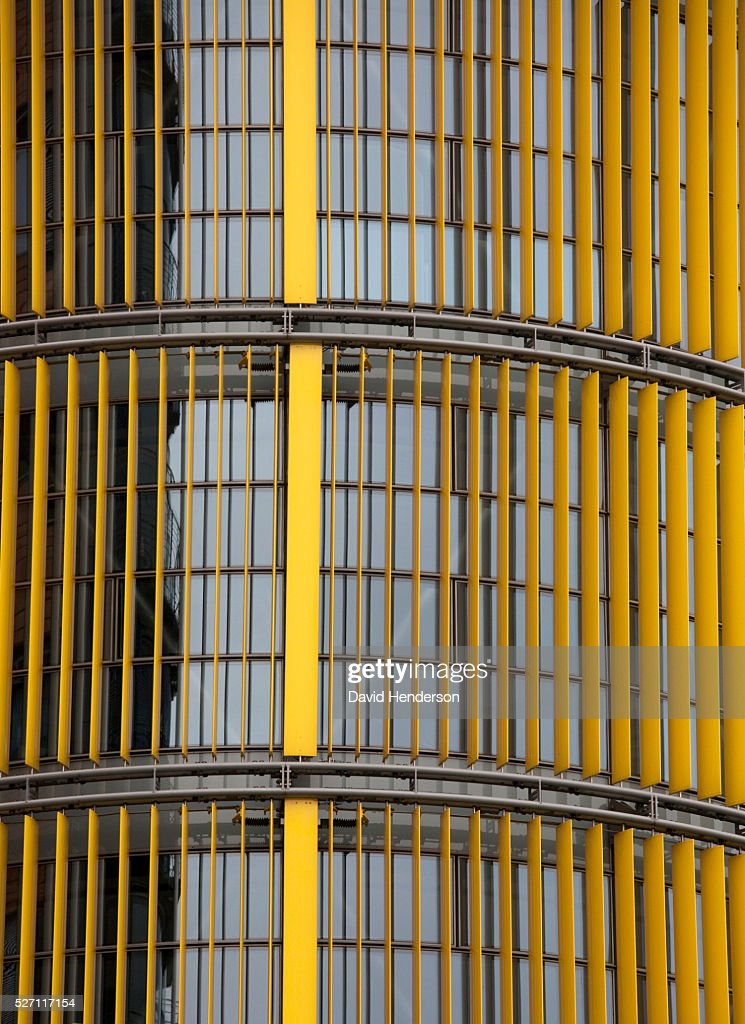 Yellow blinds on the exterior of a skyscraper : Stock Photo
