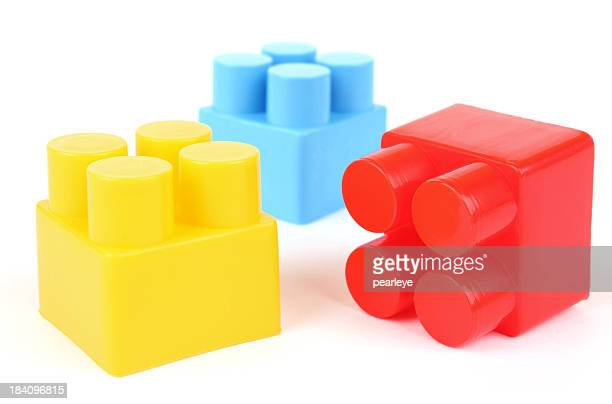 Yellow, blue, and red plastic building blocks