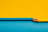 Photography of a yellow and blue pencil.