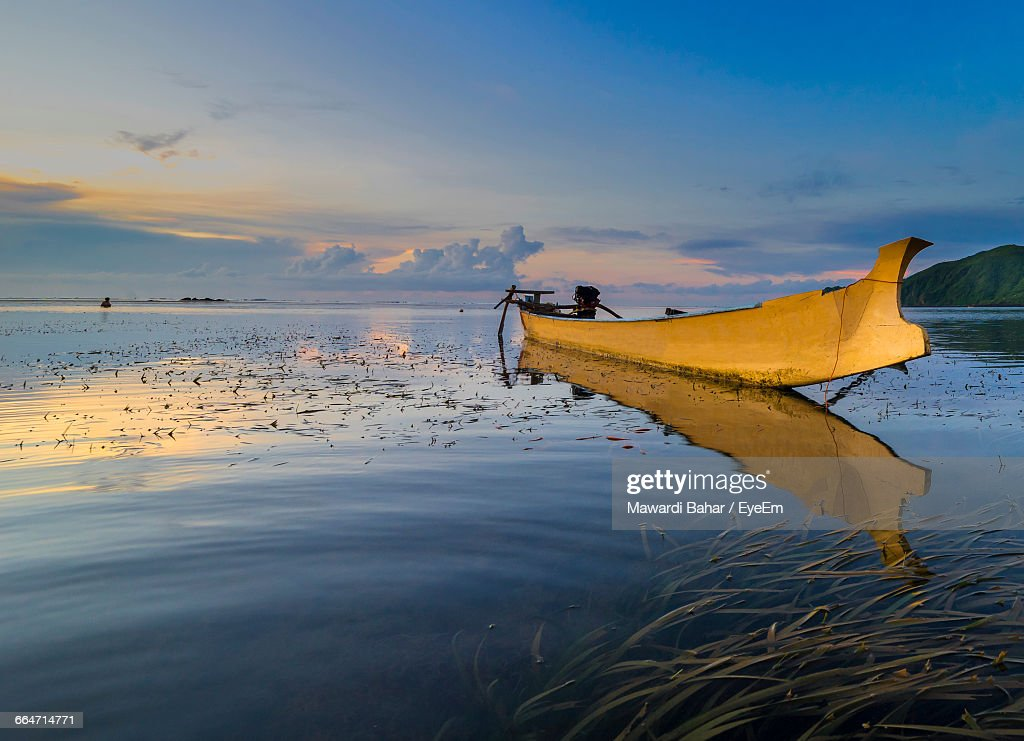 Yellow Boat Moored In Sea
