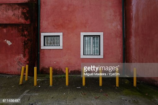 Yellow Bollards Outside Red Building