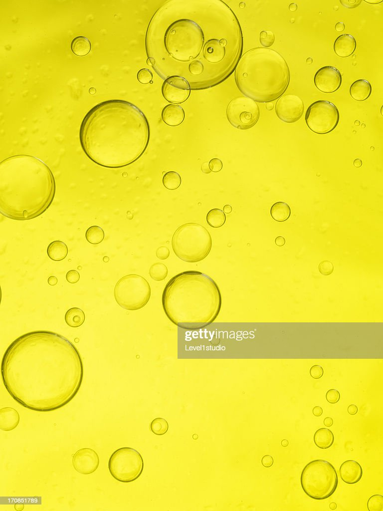 Yellow bubbles of oil and water