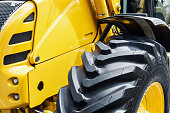 yellow bulldozer with a big wheel. focus on the wheel