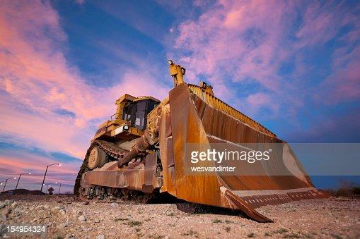 Yellow bulldozer working at Sunset