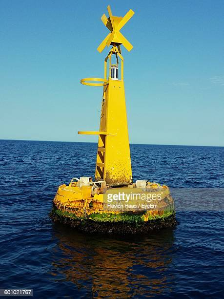 Yellow Buoy On Sea Against Sky