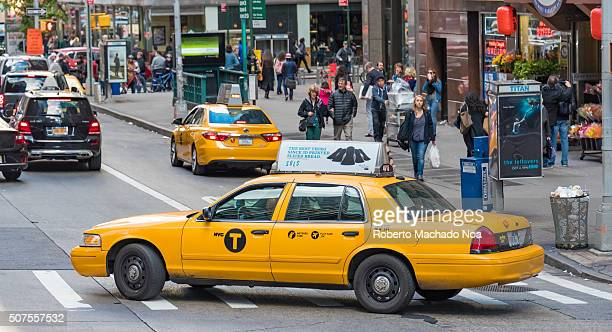 Yellow cab drives through the streetsthey are the most widely recognized icons of the city