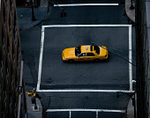 Yellow cab in middle of crossroad, New York, New York State, USA