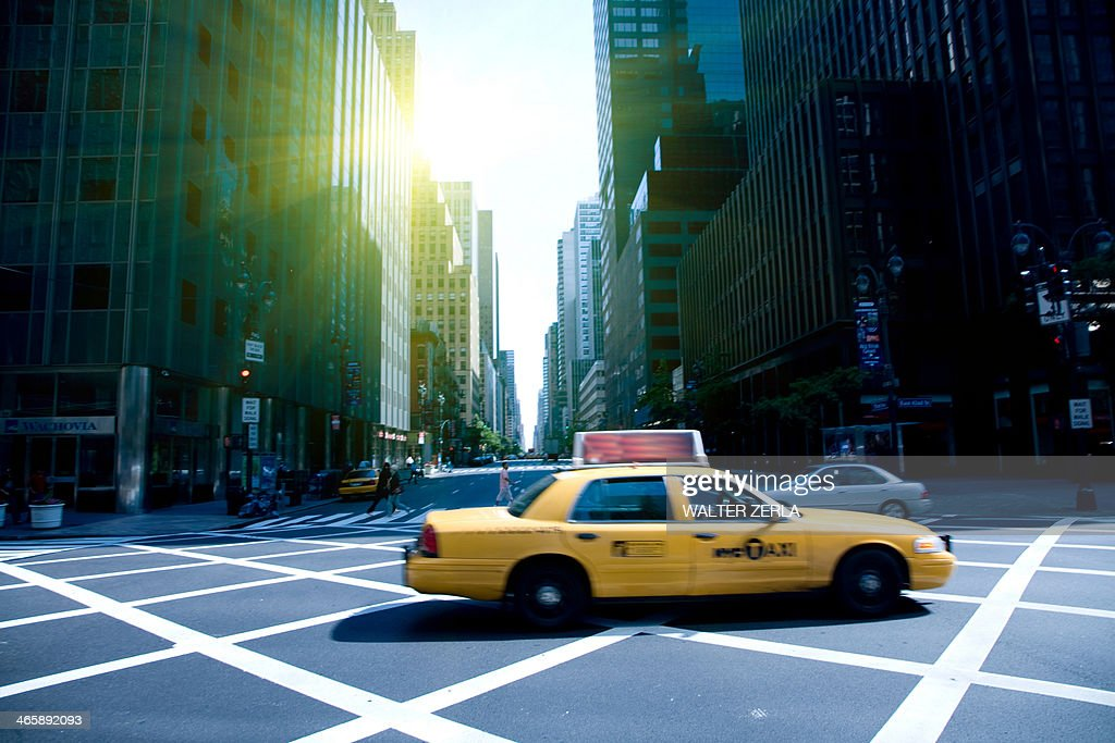 Yellow cab on grid, New York, New York State, USA