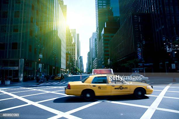 Yellow cab on grid, New York, New York State, USA