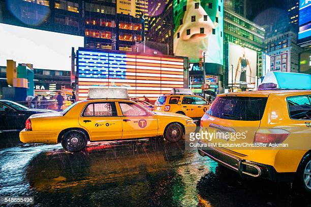 Yellow cabs and neon signs in Times Square at night, New York, USA