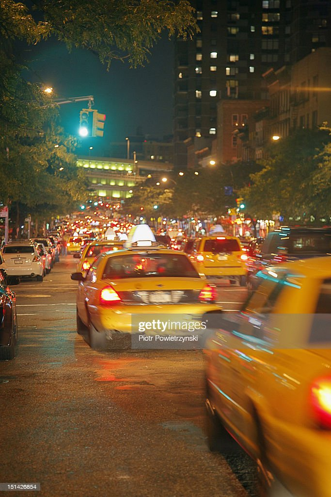 Yellow cabs at night, Manhattan, New York City : Stock Photo