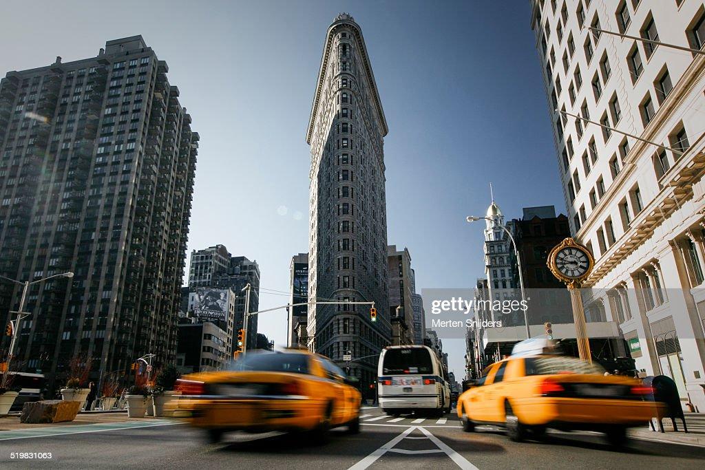 Yellow cabs below Flatiron building