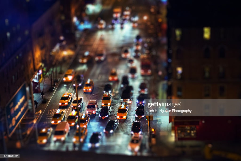 Yellow cabs in New York at night : Stock Photo