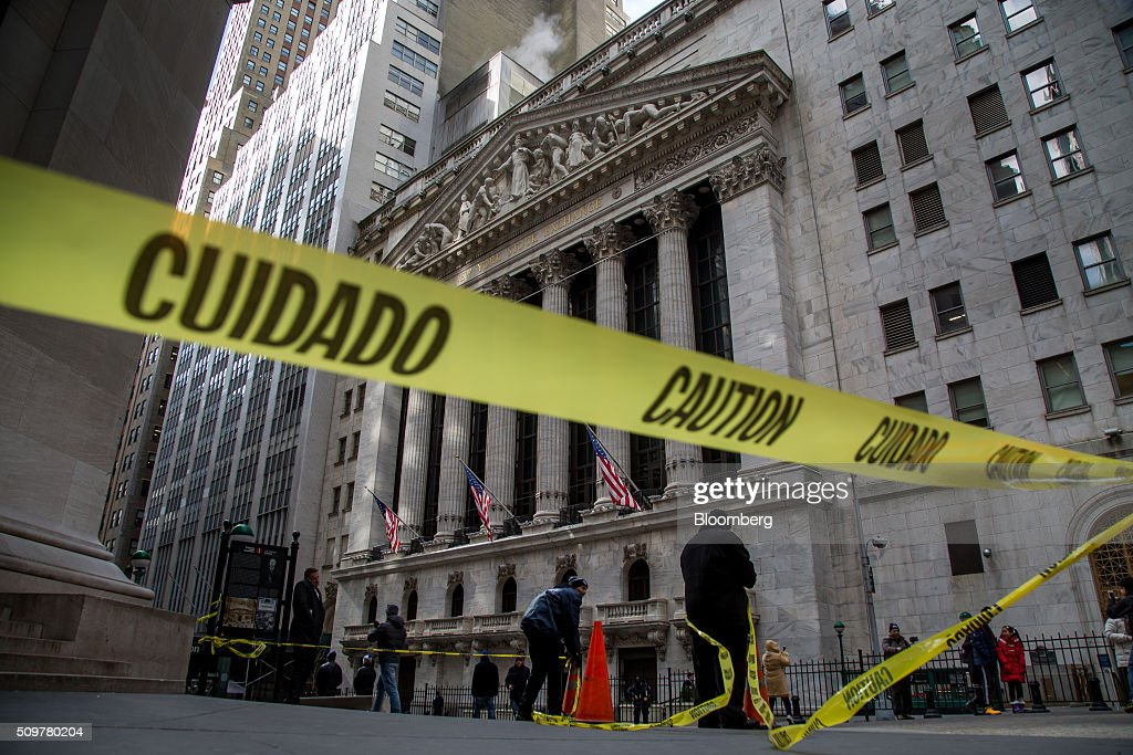 Yellow 'Caution' tape is displayed outside of the New York Stock Exchange (NYSE) in New York, U.S., on Friday, Feb. 12, 2016. U.S. stocks halted a five-day slide that dragged global equities into a bear market, as oil rebounded from a 12-year low and bank shares surged. Photographer: Michael Nagle/Bloomberg via Getty Images