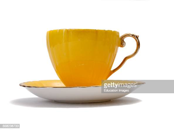 Yellow china tea cup on a white background