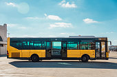 A yellow city bus parked