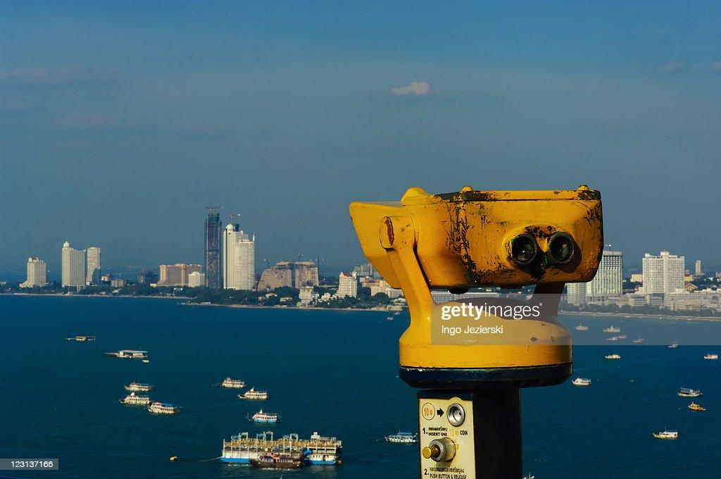 Yellow Coin-operated Binoculars over Pattaya : Stock Photo