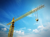 Yellow construction frame against blue sky background.