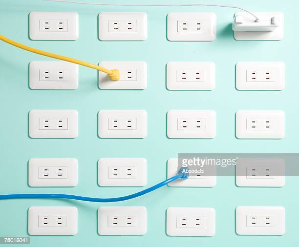Yellow cord, Blue cord and computer adapter plugged in, row of plug socket