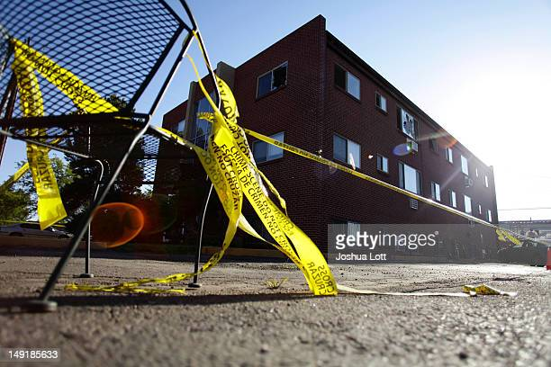 Yellow crime scene tape surrounds the apartment building where suspect James Holmes lived July 24 2012 in Aurora Colorado Holmes is accused of...