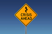 Yellow crisis ahead  traffic sign on blue sky. Crisis concept. Horizontal composition with copy space. Clipping path is included.