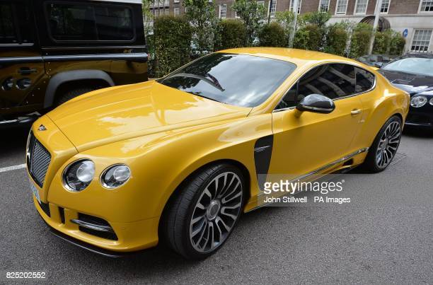 A yellow custom Bentley with Dubai number plates outside the Park Tower Knightsbridge Hotel in London as August sees hundreds of Middle Easterners...