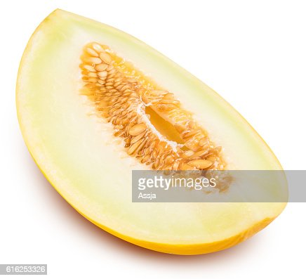 Yellow cut melon isolated on white background : Foto de stock