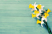 Daffodils bouquet on wooden table