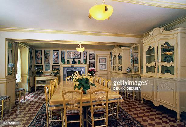 Yellow dining room in Claude Monet's house Giverny Upper Normandy France