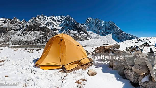 Yellow dome tent high mountain camp snow summits Himalayas Nepal
