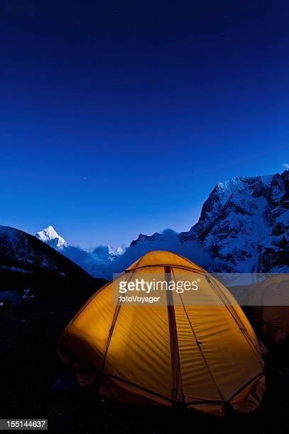 Yellow dome tent starry sky mountain peaks Himalayas Nepal