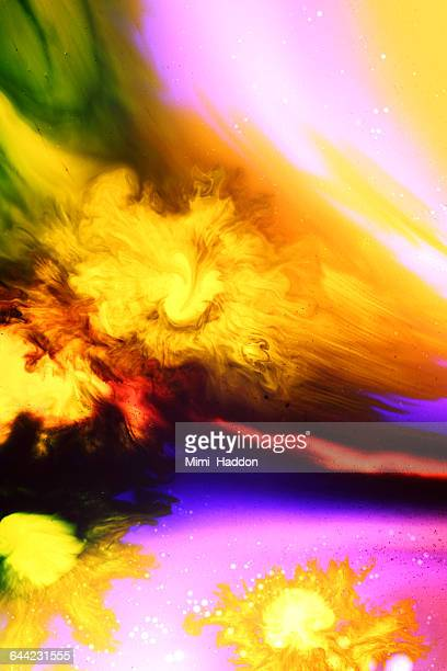 Yellow Dyes Exploding in Colorful Liquid