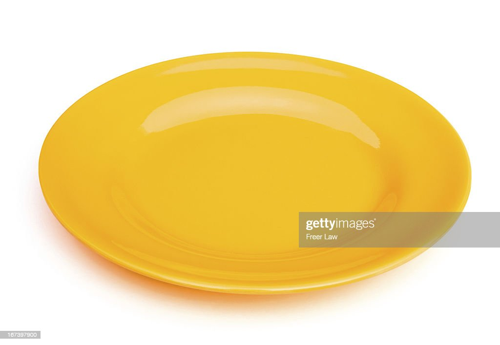 yellow empty plate on white with clipping path : Stockfoto