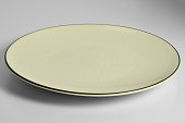 Empty Yellow enamelled plate with chapped effect with black border