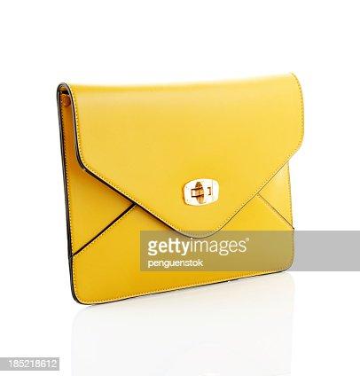 Yellow envelope style handbag isolated on white background