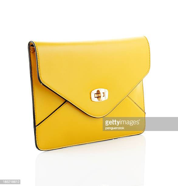 Yellow envelope style handbag isolated on white background