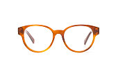 Yellow eyeglasses in round frame transparent for reading or good vision, front view isolated on white background.