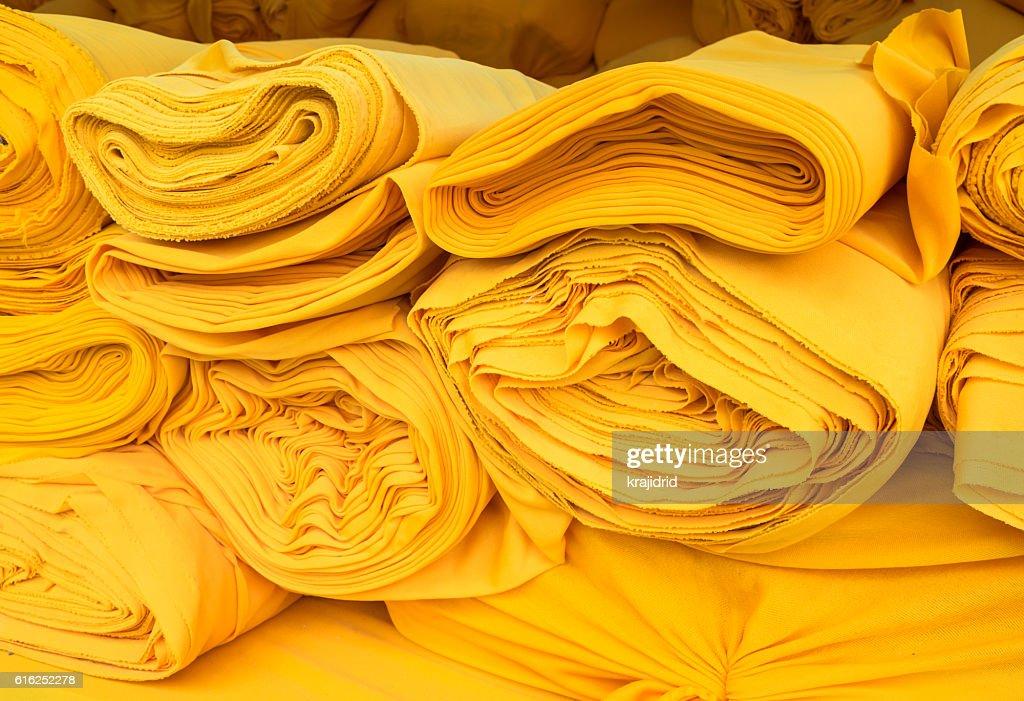 Yellow fabric roll : Foto de stock
