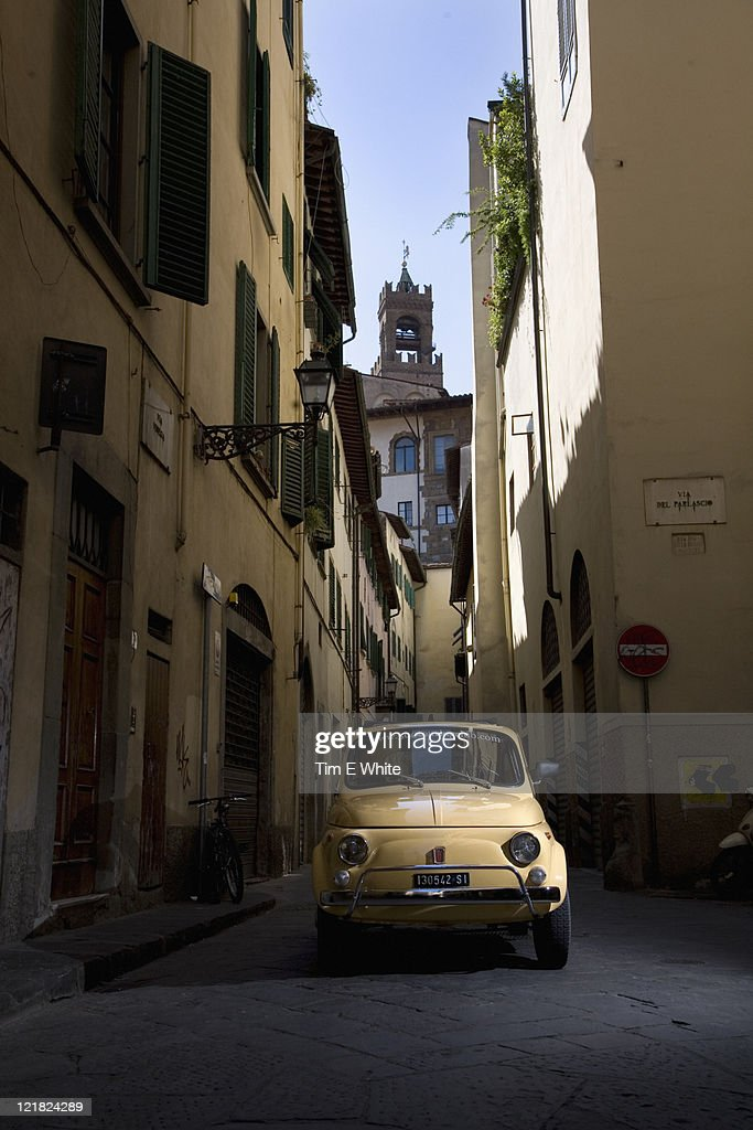 Yellow Fiat 500 in Florence, Italy