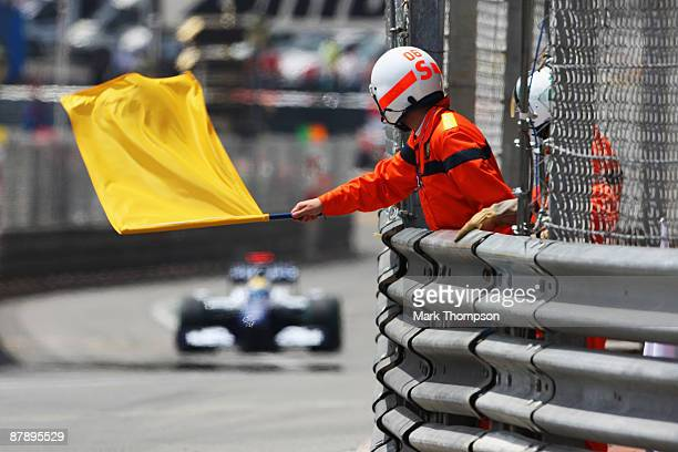 Yellow flag is waved by marshalls during practice for the Monaco Formula One Grand Prix at the Monte Carlo Circuit on May 21 2008 in Monte Carlo...