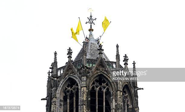 Yellow flags fly on the cathedral tower of the historic Dutch city of Utrecht on November 8 where the 2015 Tour de France cycling race will start...