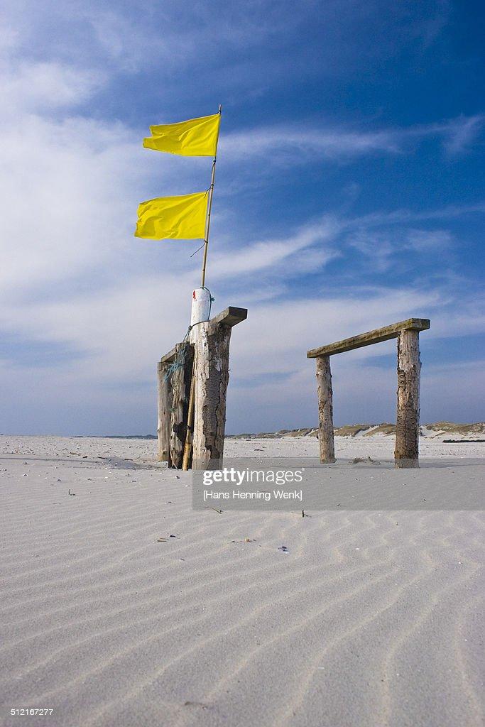 Yellow Flags on Beach