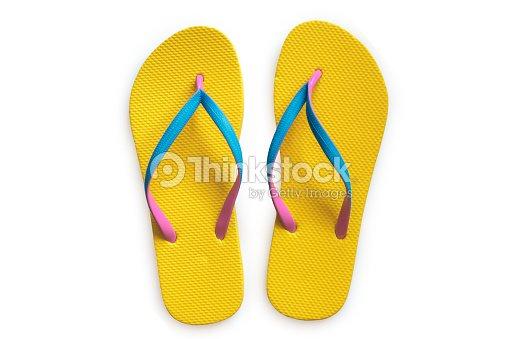 6c7e138d3f71 Yellow Flip Flops Isolated On White Background Stock Photo - Thinkstock